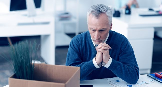 Emotionally washed out man dreaming at work