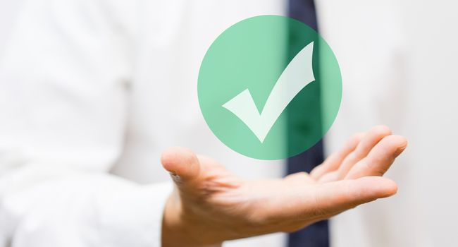 businessman showing virtual approved check mark