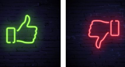 Green Thumbs up and red Thumbs down neon symbols isolated on dark brick background. Vector design elements.