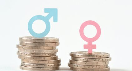 Male and female symbols on piles of coins – Gender pay equality concept