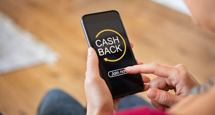 Woman using cashback app on phone