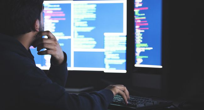 Student working late on his complex computer programming