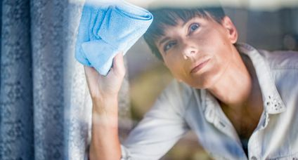 Adult Woman Cleaning a Window