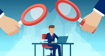 Vector of two managers with magnifying glass watching over at employee working at his desk on computer