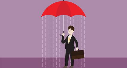 Businessman holds an umbrella with rain