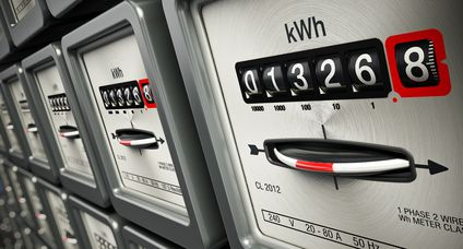 Electric meters in a row standing on the wall