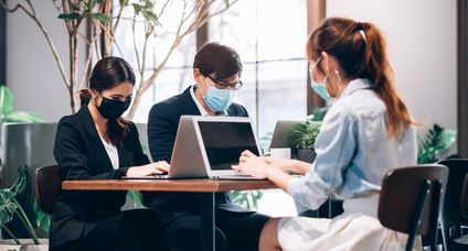 Group of Asian People Successful Teamwork Businessman and Businesswoman Wearing Medical Mask Working with Laptop. Work from Private Home Office Social Distancing among Coronavirus Outbreak Situation