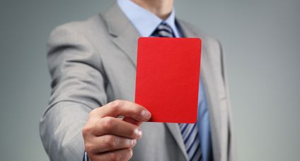 Businessman showing the red card