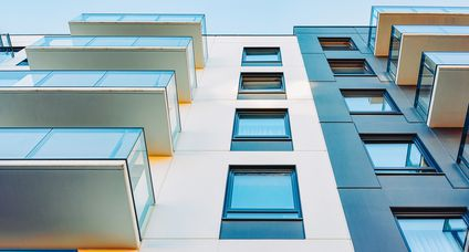 Facade of new modern apartment house copy space