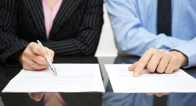 businessman and businesswoman are inspecting  contract