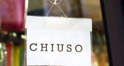 """CHIUSO"" Sign Hangs in Shop Window in Italy"