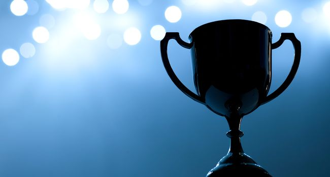 Silver Trophy competition in the dark on the abstract blurred light background with copy space, Blue Tone