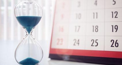 Hour glass and calendar important appointment date, schedule and deadline