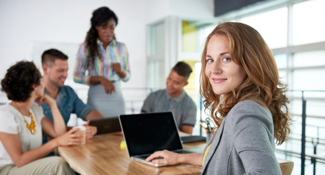 Image of a succesful casual business woman using laptop during